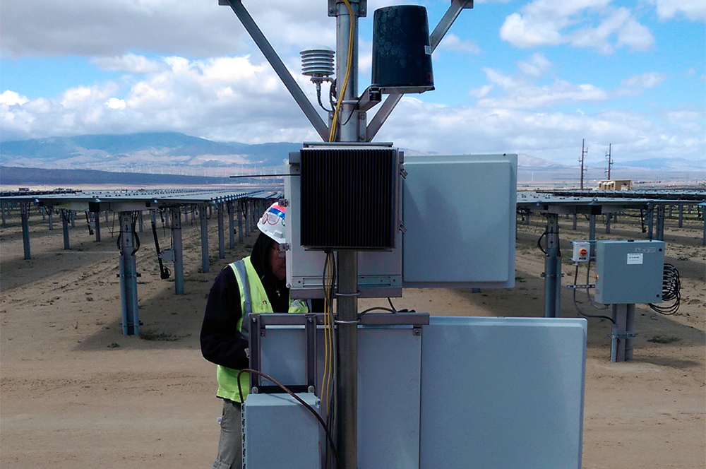 Trimax technician at solar field photo