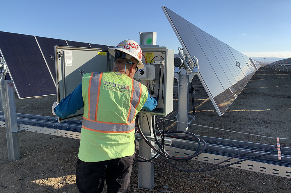 Trimax technician working inside a panel at the solar field photo