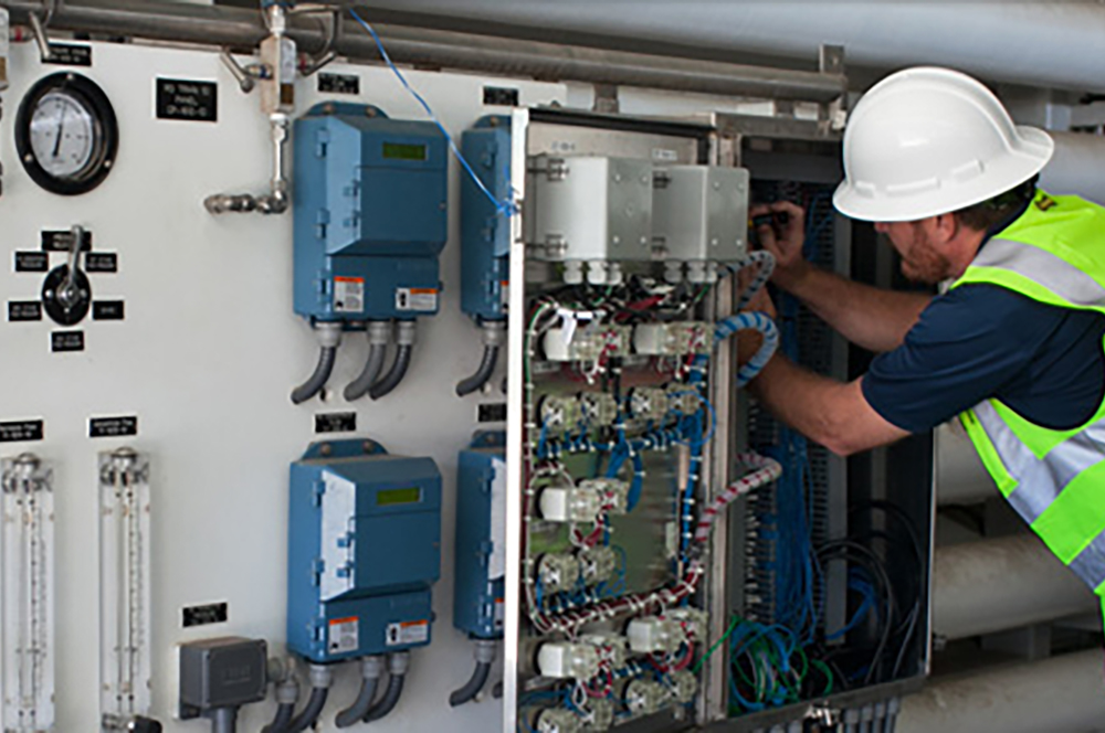 Person working inside a panel onsite