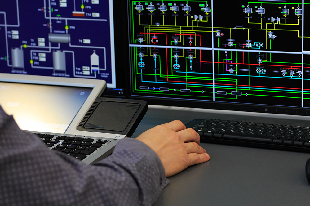 Close up of person working on a SCADA screen